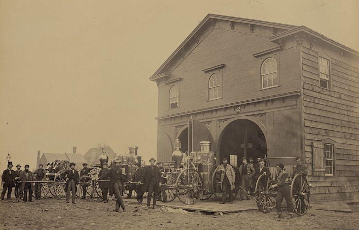 Photograph of United States Fire Department in Alexandria, Virginia with steam fire engines out front, July 1863